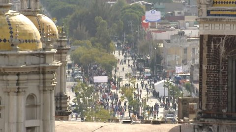 MEXICO CITY, MEXICO - DECEMBER 12, 2012: Zoom shot over old basilica from Tepeyac Hill reveals crowd of Catholics walking to the Plaza Mariana in Mexico City to visit the Virgin on December 12, 2012.
