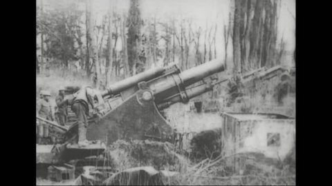 CIRCA 1918 - Australian artillery observers watch a bombardment at the Hindenburg Line and a 9.2 inch Howitzer is fired in France during World War 1.