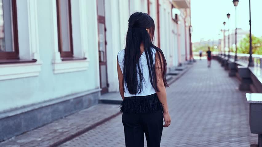 Portrait of a cute and gorgeous asian woman in fashion dress walking along bright european street   Shutterstock HD Video #31730053