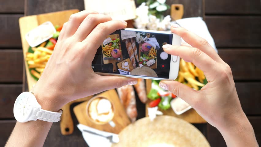 Hands Using Smartphone Taking Photos Of Hipster Flat Lay With Burgers, French Fries, Coffee and French Baguettes. Closeup. 4K.  | Shutterstock HD Video #31738723