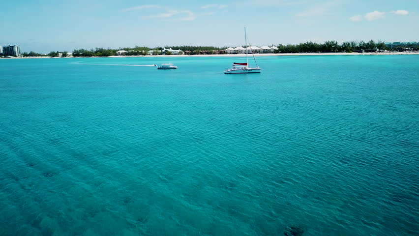 aerial view over tropical water and golden sands in the tropical paradise of the cayman islands in the caribbean