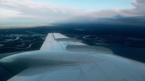 view from the window of the plane that goes on boarding, Yamal, Siberia