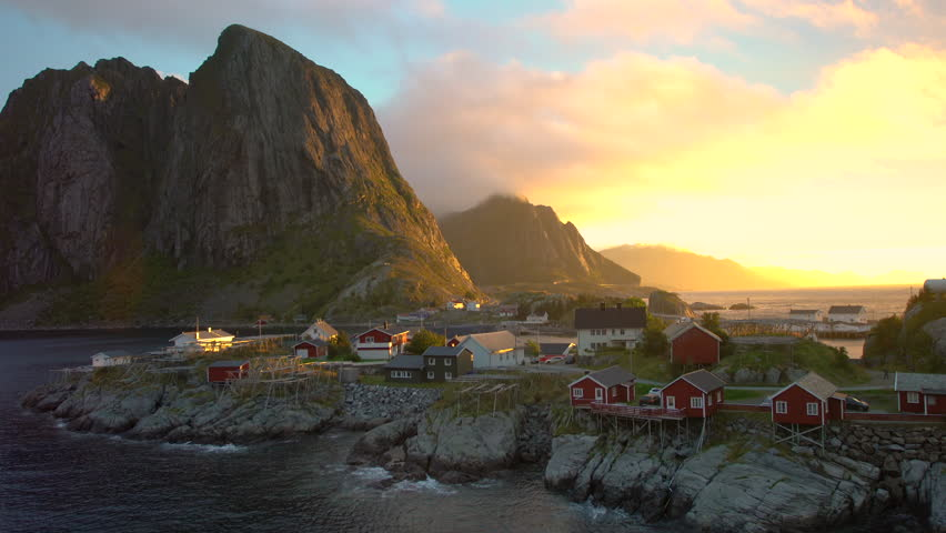 Red wooden huts, known as Rorbu, in the village of Reine on the Hamnoy island, Lofoten Islands, Norway. Rorbu is a Norwegian traditional house used by fishermen,today most are used by tourists.