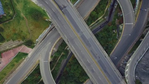 Aerial shot of cars riding on different roads in Bogota, Colombia