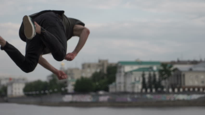 The guy jumps and does a somersault | Shutterstock HD Video #31845373