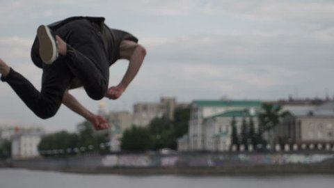 The guy jumps and does a somersault