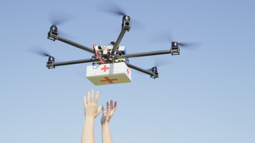 CLOSE UP: UAV aerial drone delivery. Multicopter flying with first aid medicine package. Person' arms receiving first aid SOS delivery drone from sky. Medical air shipment by first responder drone