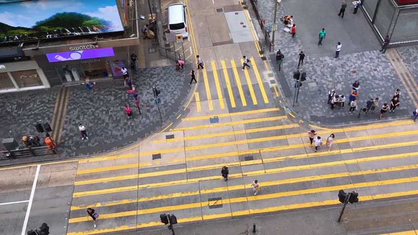 HONG KONG, CHINA - SEPTEMBER, 14, 2017: The bird view of the traffic and pedestrians in the downtown of Hong Kong, China    Shutterstock HD Video #31877575