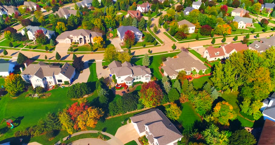 Beautiful neighborhoods, homes amid Autumn colors, aerial view.  | Shutterstock HD Video #31890940