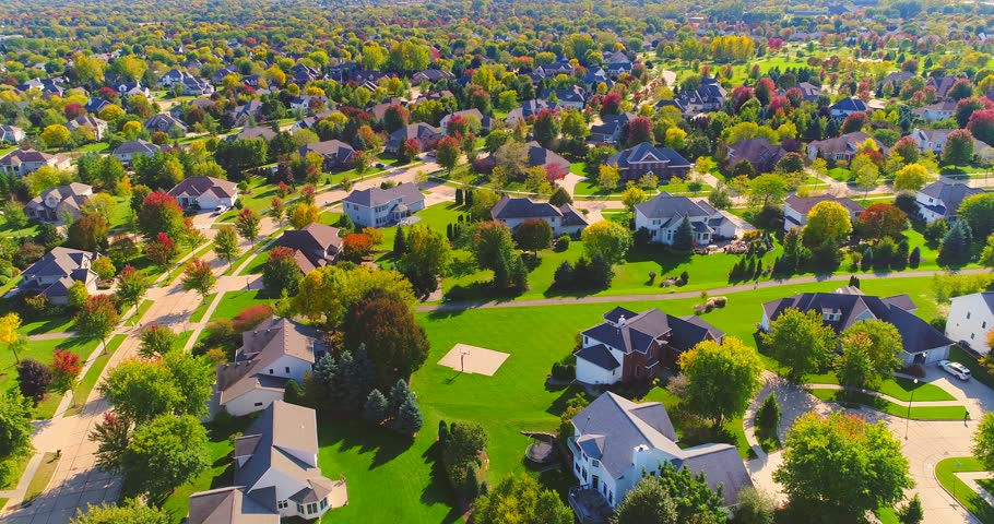 Beautiful neighborhoods, homes amid Autumn colors, aerial view.  | Shutterstock HD Video #31890943