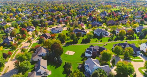 Beautiful neighborhoods, homes amid Autumn colors, aerial view.