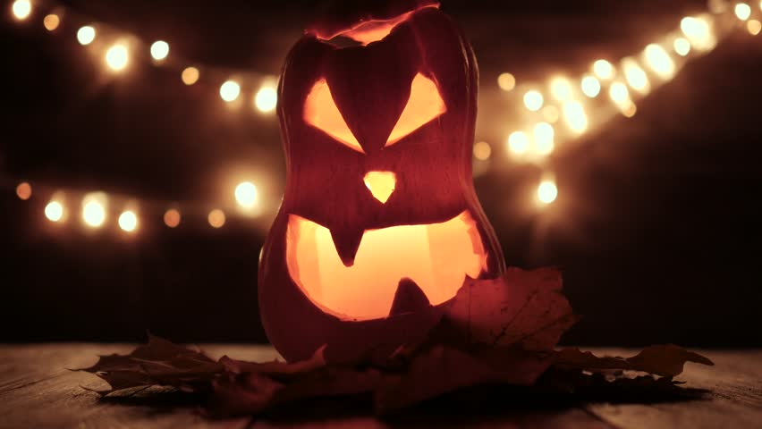 Carved Halloween pumpkin with lights on background. Dark key footage in UltraHd resolution. | Shutterstock HD Video #31903903