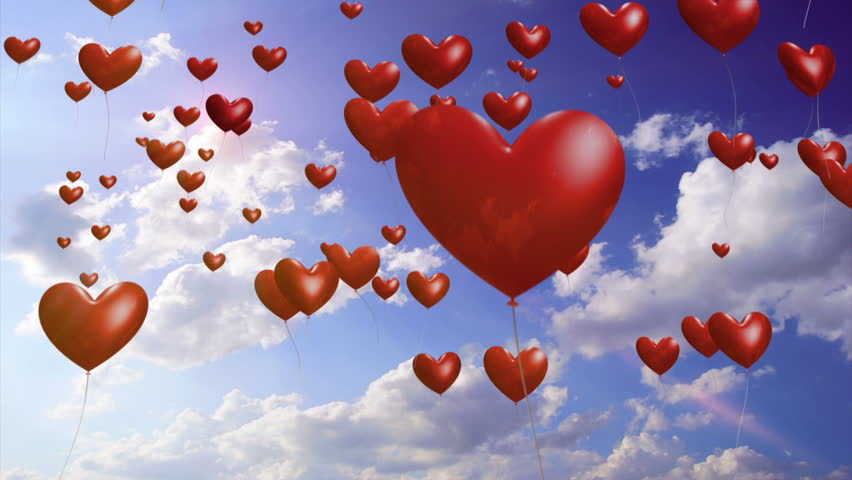 Heart Balloons - Romantic / Wedding Video Background Loop  ///  Heart-shaped balloons rise into a sunny sky. This is a gorgeous video background for weddings, parties and celebrations.