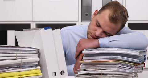 Accountant Man Sleeping on Office Desk Stack of Folder Exhausted Day Bookkeeping