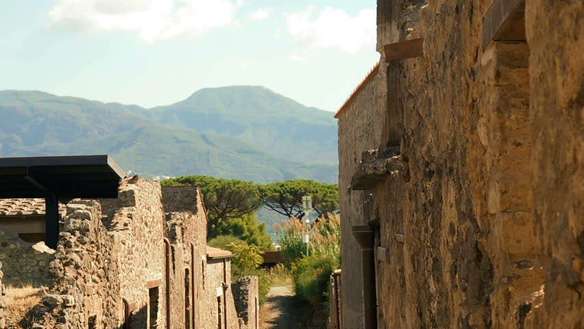 Ruins of Pompeii in Pompei,Travel Italy Europe. Ruins Of Ancient City Pompeii. Famous Archaeological Area. UNESCO World Heritage - Popular Tourist Attractions In Italy. Eruption Of Volcano Vesuvius.