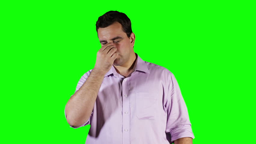 Young Man Hurting Nose GreenScreen  Footage was shot against green screen and keyed out. The bg is pure green, removing the green is only 1 click. Green spills are removed. | Shutterstock HD Video #3194083