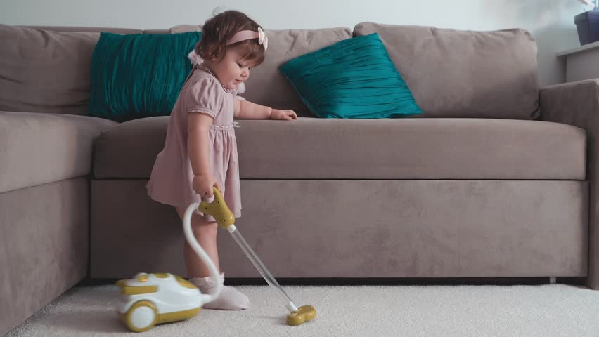 Cute little baby girl using toy vacuum cleaner in room | Shutterstock HD Video #31966693