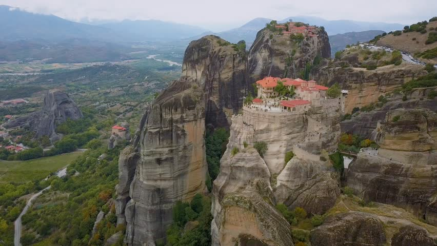 Flight over the rock formations and monasteries of Meteora, Greece.
