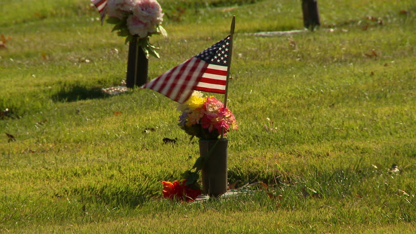 On Veteran's Day, small American flags are placed on the graves of veterans in honor of their service.