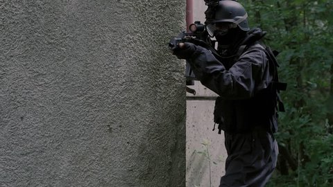 Close Up Special Force Team enter a rustical house.