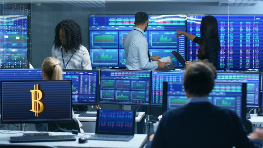 Multi-Ethnic Team of Traders is Busy Working with Cryptocurrency at the Stock Exchange Office. Dealers and Brokers Buy and Sell Stocks on the Market. Monitors Display Relevant Data and Numbers. 4K UHD | Shutterstock HD Video #32033593