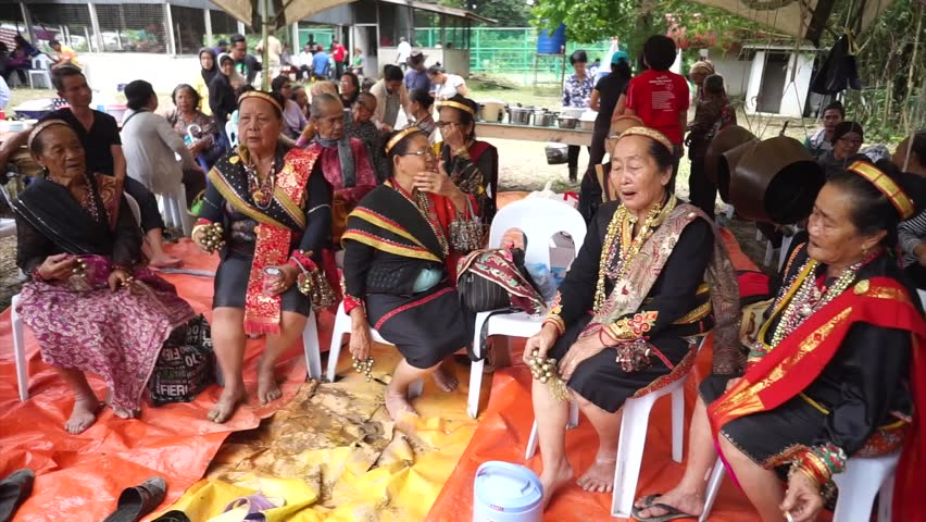 Tuaran Sabah Malaysia - Oct 21, 2017: Tantagas or priests of Lotud tribe performing a cleansing ritual called Mamahui Pogun meant to heal the world of its adversity caused by the unholy act of incest.