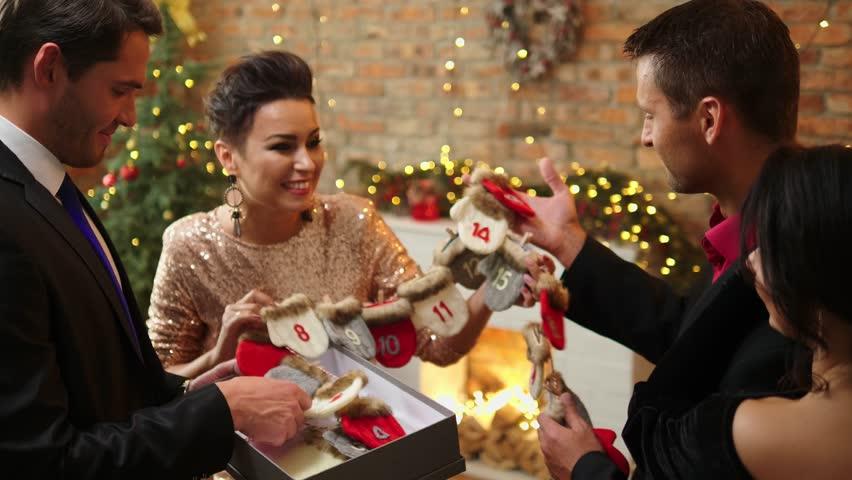 Happy beautiful couples celebrating Christmas - 4K stock video clip