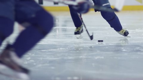Ice hockey. A hockey player does dribbling. Possession of the puck.