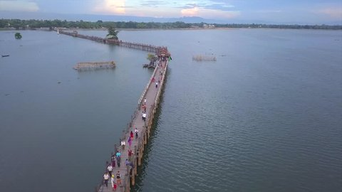 4K aerial view from the drone on the U Bein bridge, crossing that spans the Taungthaman Lake near Amarapura in Myanmar