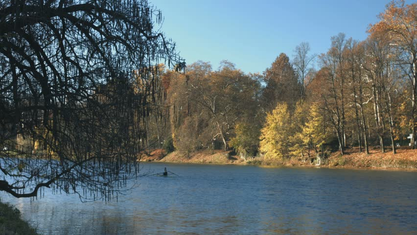 Turin in autumn along the Po river with rowers training. The city hosted the XX Winter Olympic Games in 2006