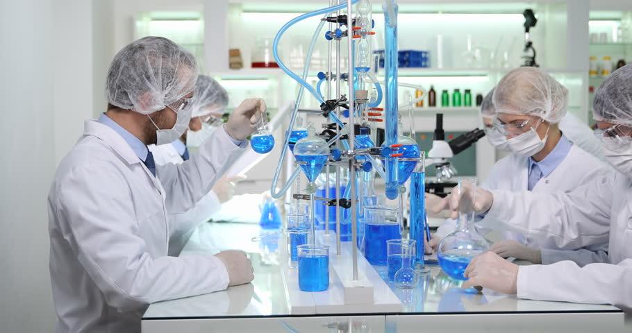 team scientists biochemists talk laboratory people discussing lab communication 4k stock footage clip
