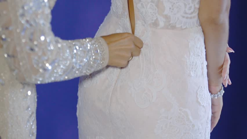 The bride puts on an elegant wedding white dress | Shutterstock HD Video #32080813