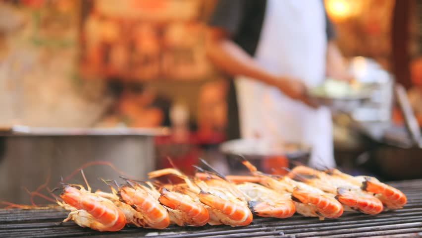 Delicious Grilled Prawns or Shrimps on Barbecue Grill. Fresh Asian Street China Town Seafood Market. Bangkok, Thailand. 4K, Slow Motion.