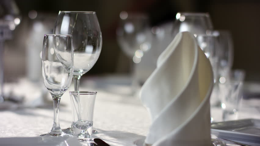 Shot of napkins and wine glasses banquet table at luxury restaurant | Shutterstock HD Video #32139133