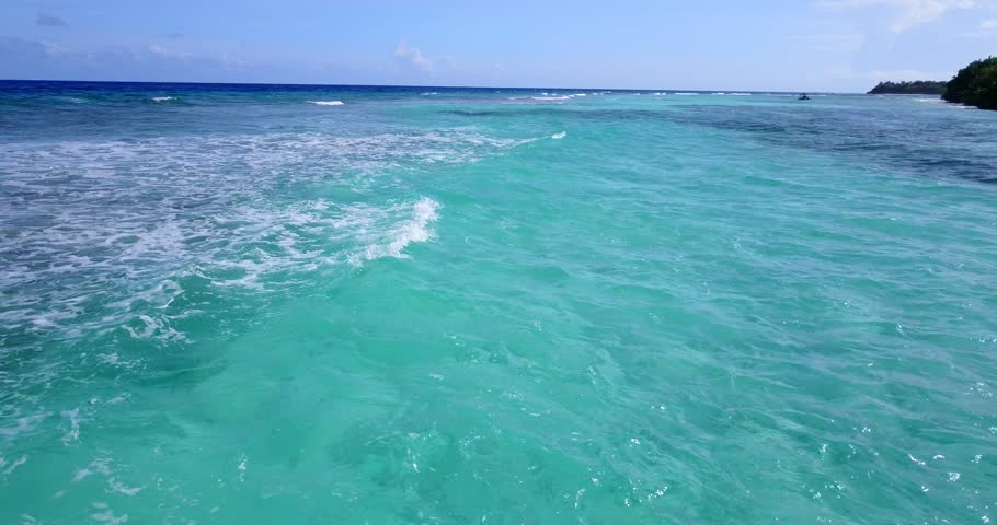v10317 maldives white sand beach tropical islands with drone aerial flying view with aqua blue sea water and sunny sky