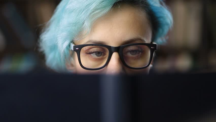 Closeup of young woman's face behind book cover | Shutterstock HD Video #32152960