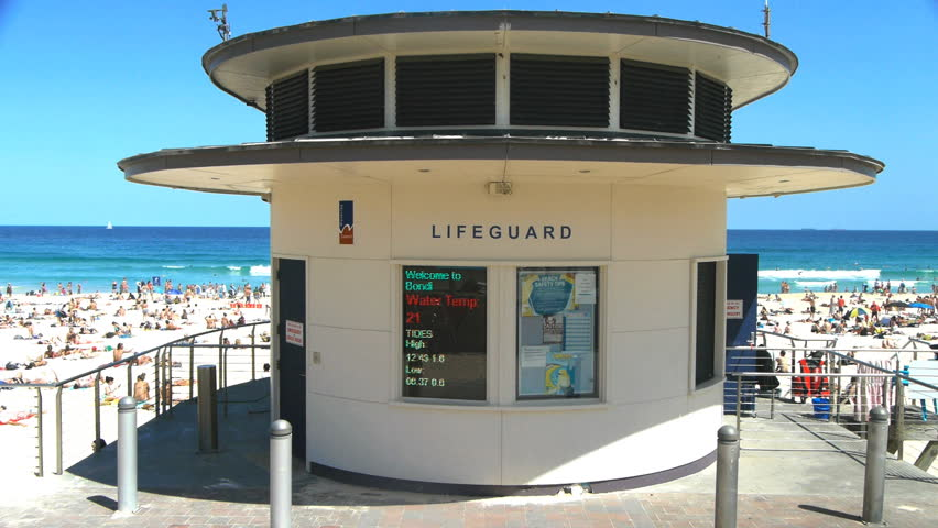 SYDNEY, AUSTRALIA - JAN 3: Bondi beach lifeguard tower on a busy summer day during the peak season in Sydney, Australia on January 3, 2013.