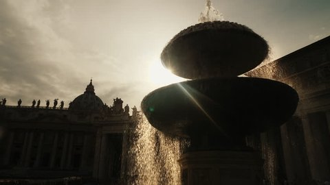 The famous Fountain of San Pietro Italian square with Saint Peter church columns, in Rome, Italy.
