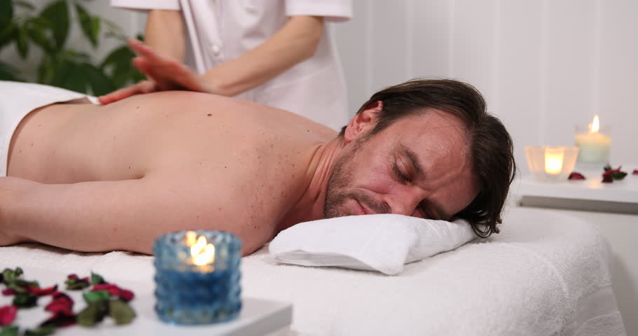 Handsome Client Man Receiving Back Body Massage In Luxury Health Beauty Spa Club