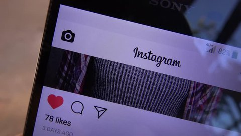 ZRENJANIN, SERBIA - OCTOBER 13, 2017: Man hits like button on Instagram page. Social media and networking editorial footage.