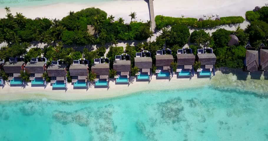 v09557 five 5 star resort water bungalows in Maldives with drone aerial flying view on white sand beach on tropical island