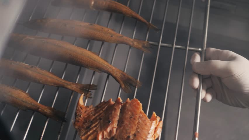 Smokehouse of fish in seafood restaurant. Smoked mackerel. Smoked fish. Dorado sea bass, smelt mullet | Shutterstock HD Video #32209093