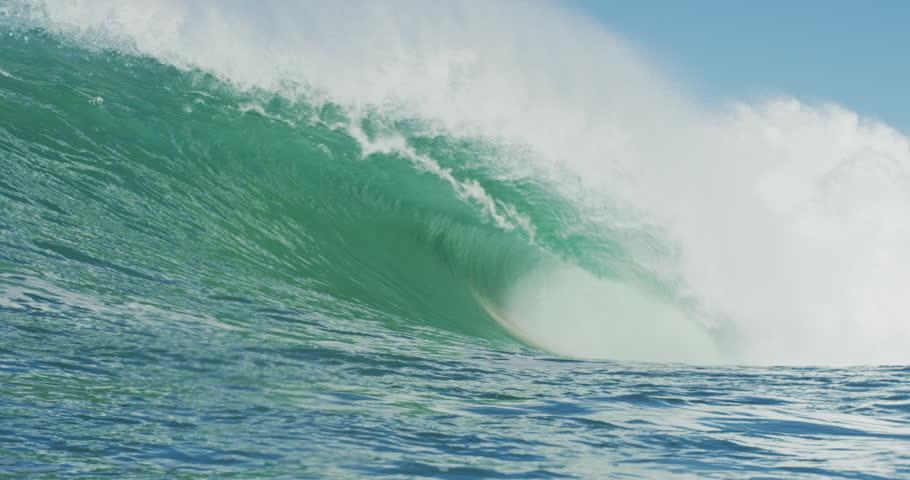 Giant Ocean Wave Breaking. Slow Motion 4K. Perfect empty beautiful wave in blue ocean  | Shutterstock HD Video #32219833