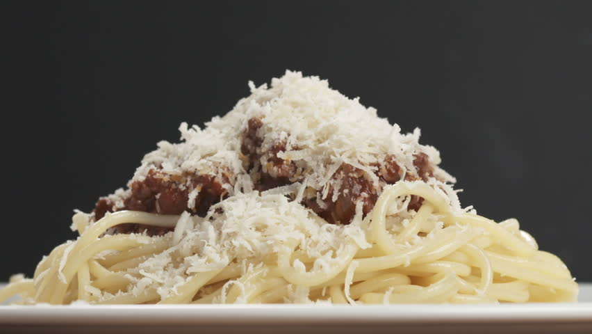 Slow motion salami sausage slices falling on spaghetti bolognese sauce | Shutterstock HD Video #32235943