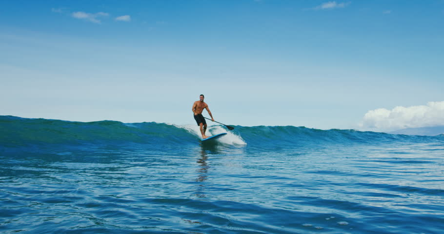 Man riding wave on stand up paddle board | Shutterstock HD Video #32245633