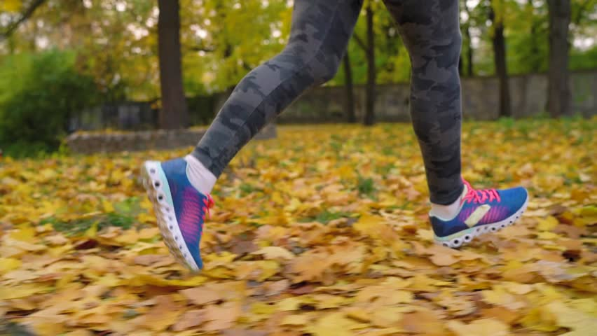 Close up of woman legs running through an autumn park at sunset. | Shutterstock HD Video #32280313