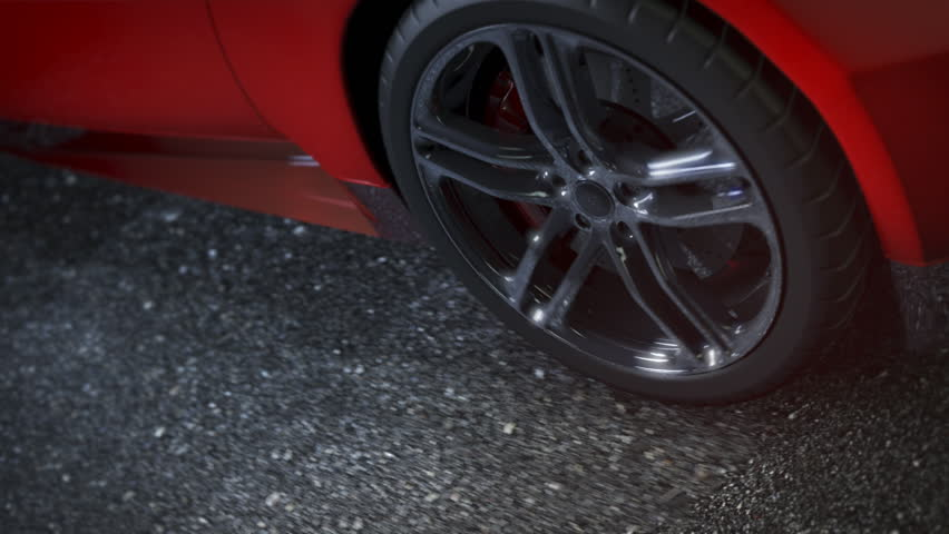 Alloy wheel of red sports car, driving on the road. Clip is loop-ready.