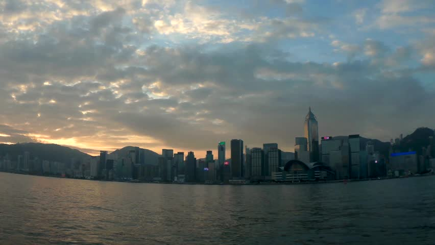 Sunrise cityscape skyline of Hong Kong. Warm yellow sun with scenic rays of light rising over modern city. Time lapse video | Shutterstock HD Video #32291353