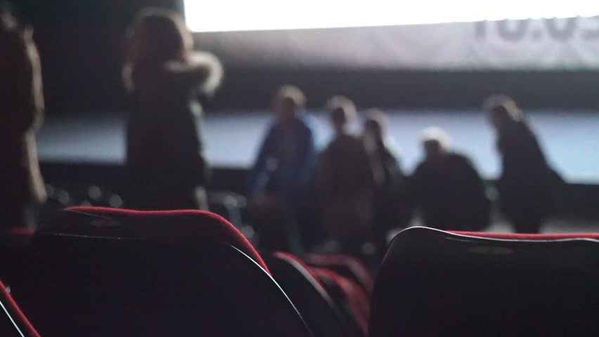 People leave auditorium during the movie performance. | Shutterstock HD Video #32296483