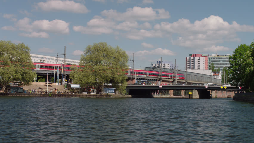 May, 2017 Berlin, Germany. Point of view of S-bahn passing the Jannonwitz Bridge train station from the Spree River on a boat.